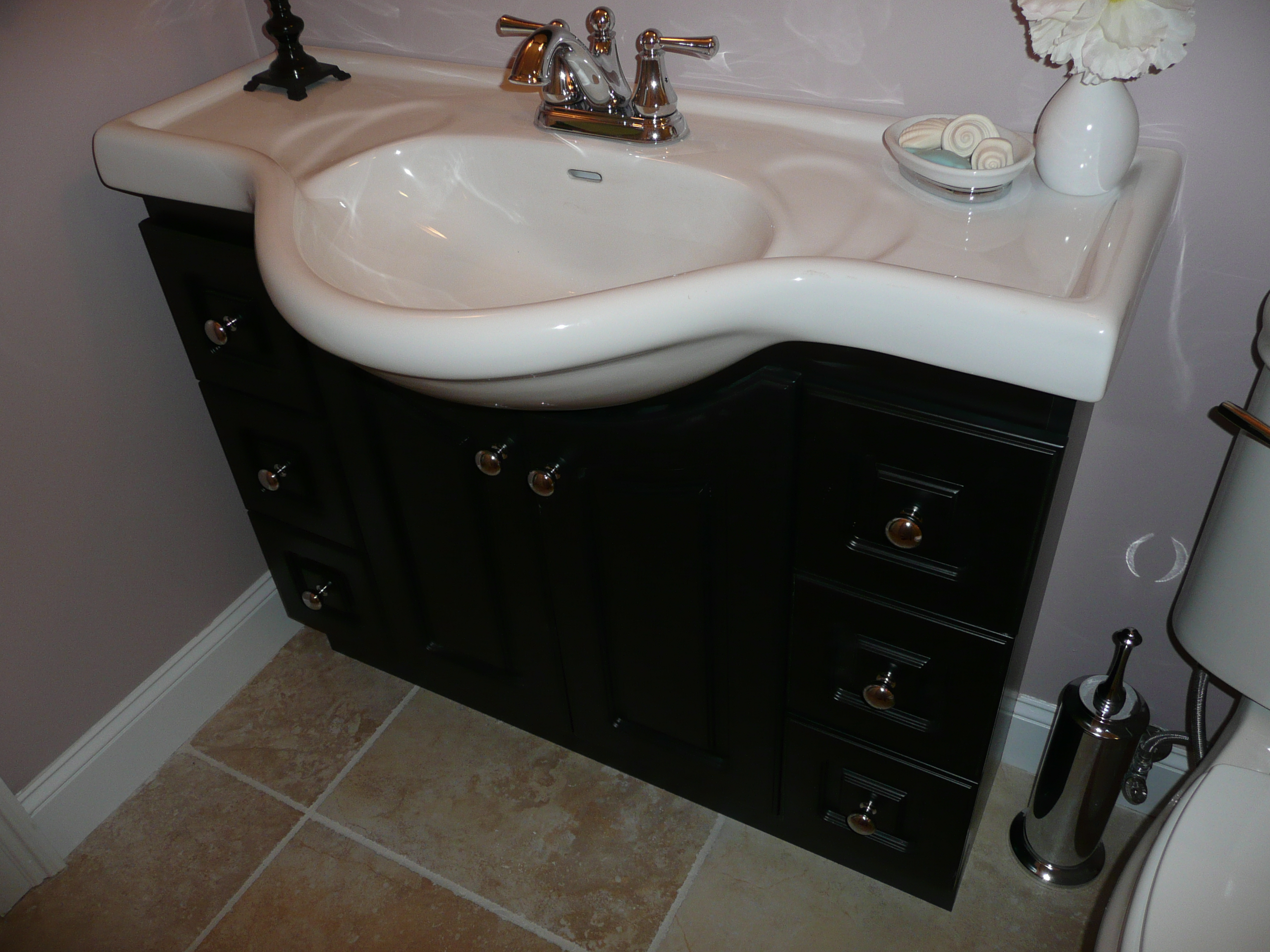 A New Euro Style Sink And Counter Base Will Enhance Small Bath Utilizing More Floor
